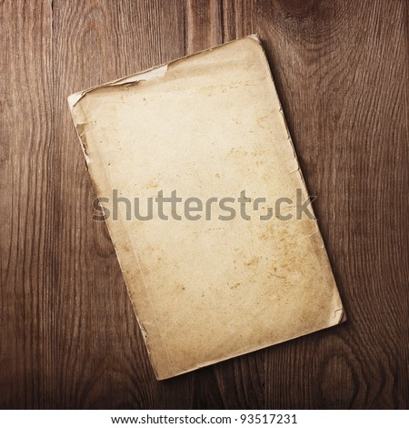 old papers on a wooden table