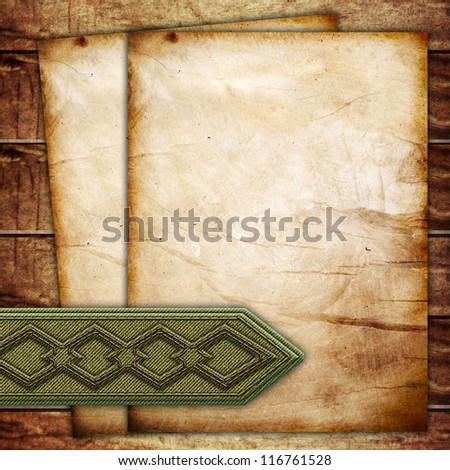 Old papers with bookmark on wooden surface