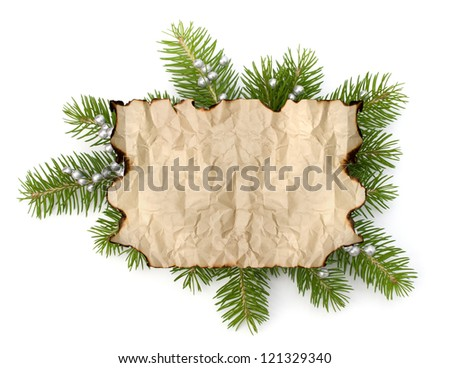 Old parchment paper with copy space on Christmas tree branch background isolated