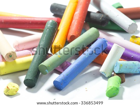 Old pastels colorful crayons on white background