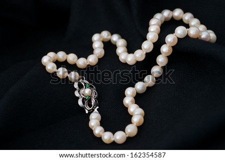 Old pearl necklace with silver clasp #162354587