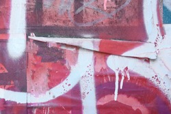 Old peeling weathered urban street posters with graffiti spray texture and paint drips