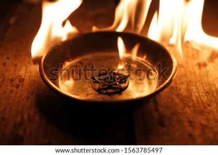 Old pentagram burning in flames