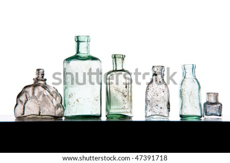 old perfumer bottles on white