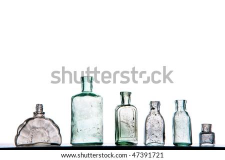 old perfumer bottles on white