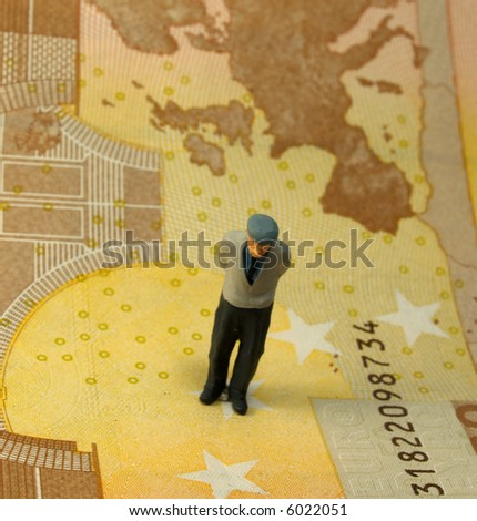 old person figure over banknote