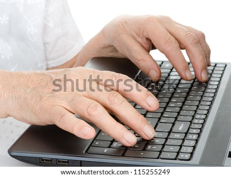 Old person hands typing on a keyboard. isolated on white background - stock photo