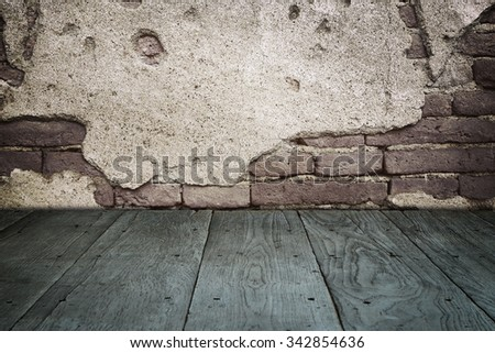 old perspective wooden floor and cracked brick wall