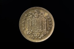 Old Peseta coin with the coat of arms of Franco's Spain formed by the eagle of San Juan