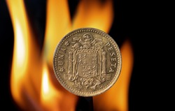 Old Peseta coin with the coat of arms of Franco's Spain formed by the eagle of San Juan with flames behind