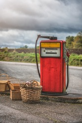 Old petrol station with vintage fuel pump and country side attributes.