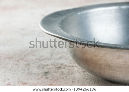 Old pewter bowl on a concrete background. Copy space for text. #1394266196