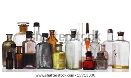 old pharmacist's bottles and beakers on white