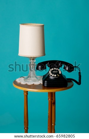 old phone and lamp on table