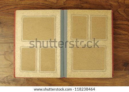 Old photo-album on wooden background
