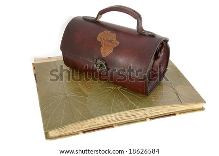 Old photo album with a purse isolated against a white background