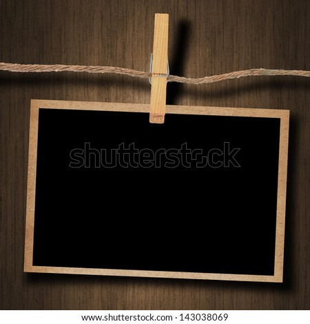old photo and clothes peg wood background