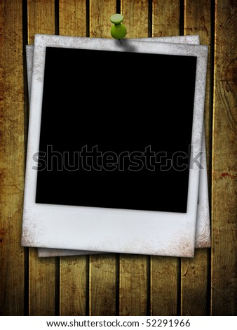 old photo frame attached on dirty wooden plank - stock photo
