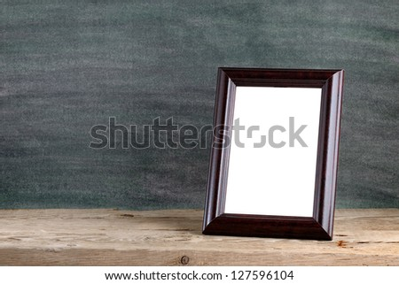 Old photo frame on wooden table
