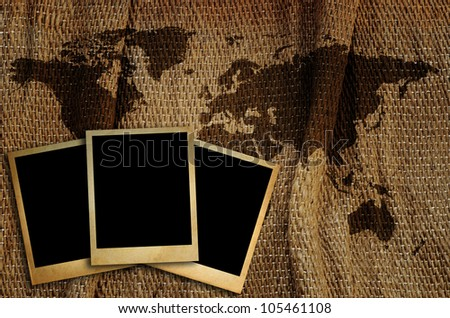 Old photo frame on world map for put  image around the world.