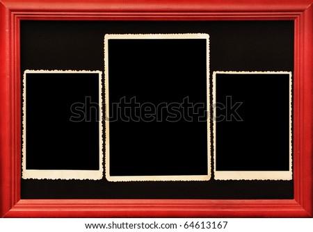 old photo in wooden frame on black