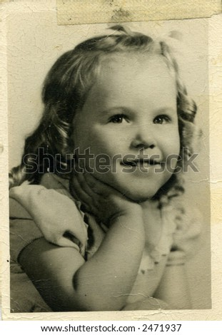 Old photo of pretty little girl