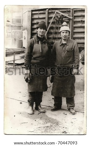 Old photo of two factory workers
