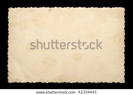 old photo paper texture isolated on a black background