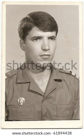 Old photo portrait of a handsome young soldier