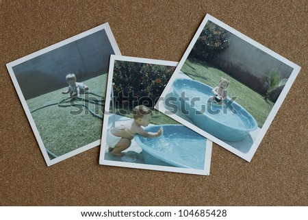 Old photographs from the 1960's of a baby girl playing in a backyard pool on a bulletin board.