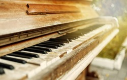 Old piano closeup outdoors in the city