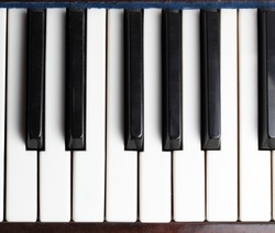 Old piano keys musical background. Acoustic classical musical instrument