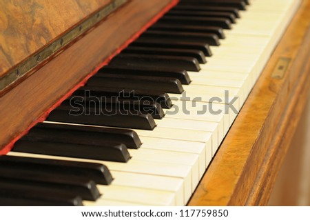 Old piano made in 1896 made of walnut-wood