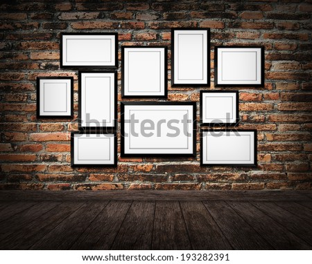 Old picture frame on brick wall in Interior of vintage room