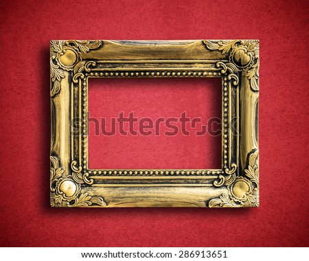 Old picture frame on grunge wall