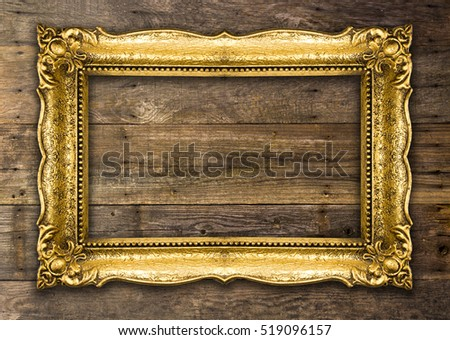 Old Picture Frame on wooden background #519096157