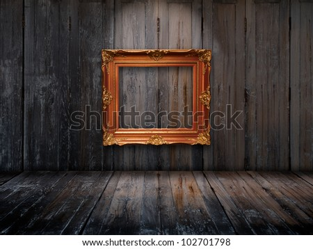 Old picture frame on wooden wall and Top light