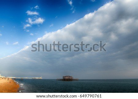 Old pier and clouds #649790761
