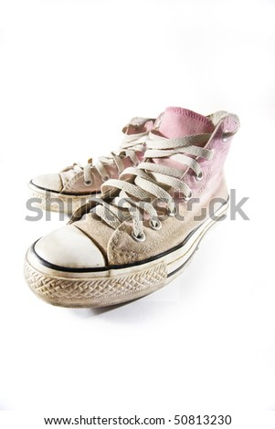 old pink sneakers - stock photo