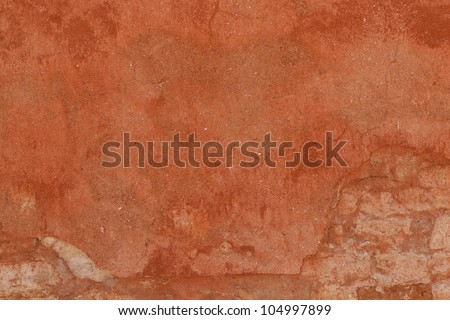 Old plaster wall texture background in Venice, Italy.