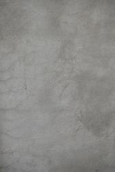 Old plaster walls, unpainted, cracks.