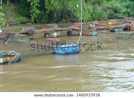 Old plastic oil tank floating in water. stock photo