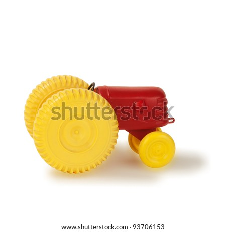 old plastic toy tractor profil isolated