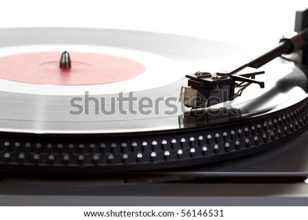 Old  player and vinyl phonograph record on a white background