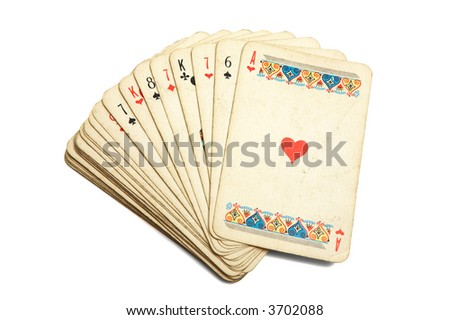 Old playing cards on a white background - stock photo