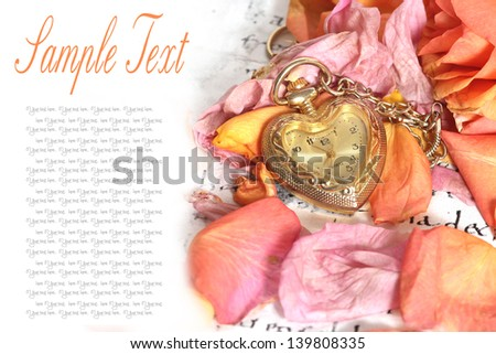 old pocket watch in a vintage romantic letter