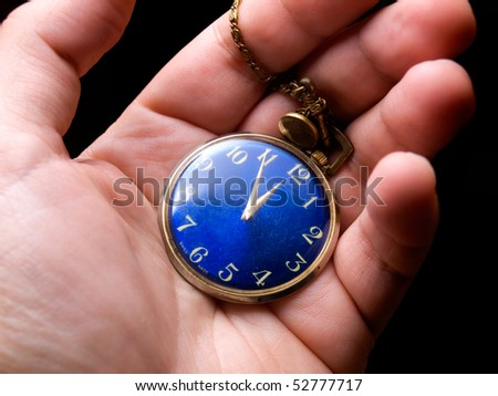 stock-photo-old-pocket-watch-in-hand-on-a-black-background-52777717.jpg