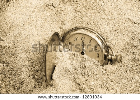 Old pocket watch lost in sand