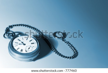 Old pocket watch with a chain, tinted blue