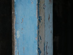 Old pole made of wood, painted blue